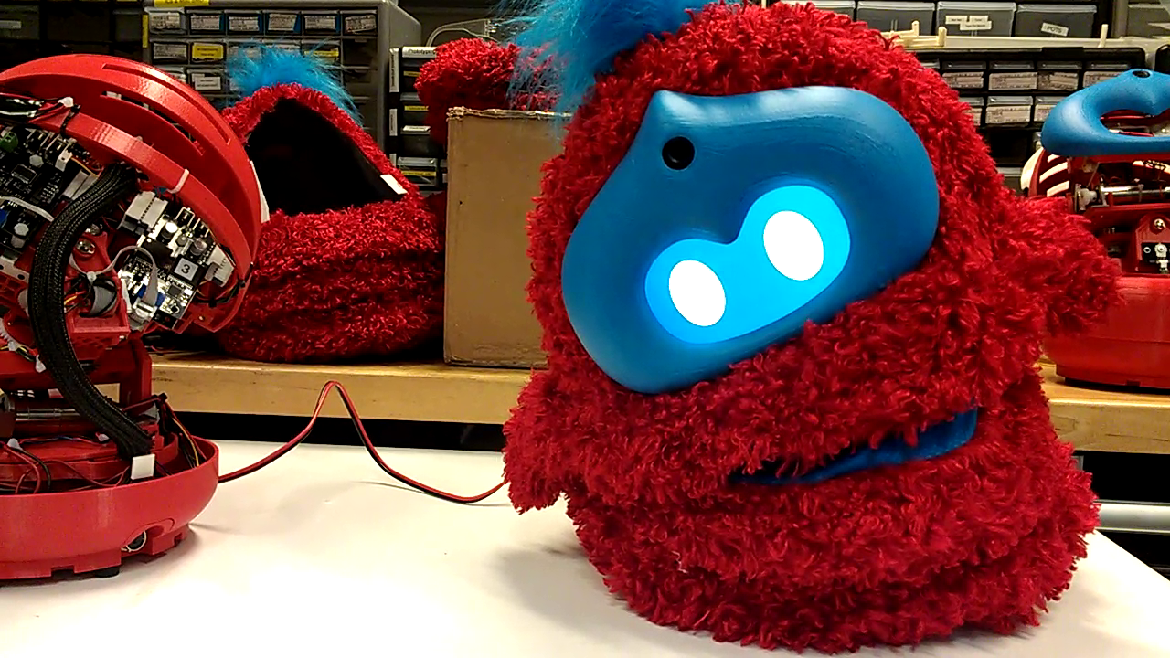 furry red and blue robot